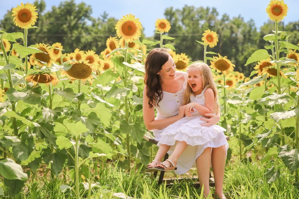 Mother and daughter laughing in sunflower field | Charleston Sunflower Field | Life With Ashley T
