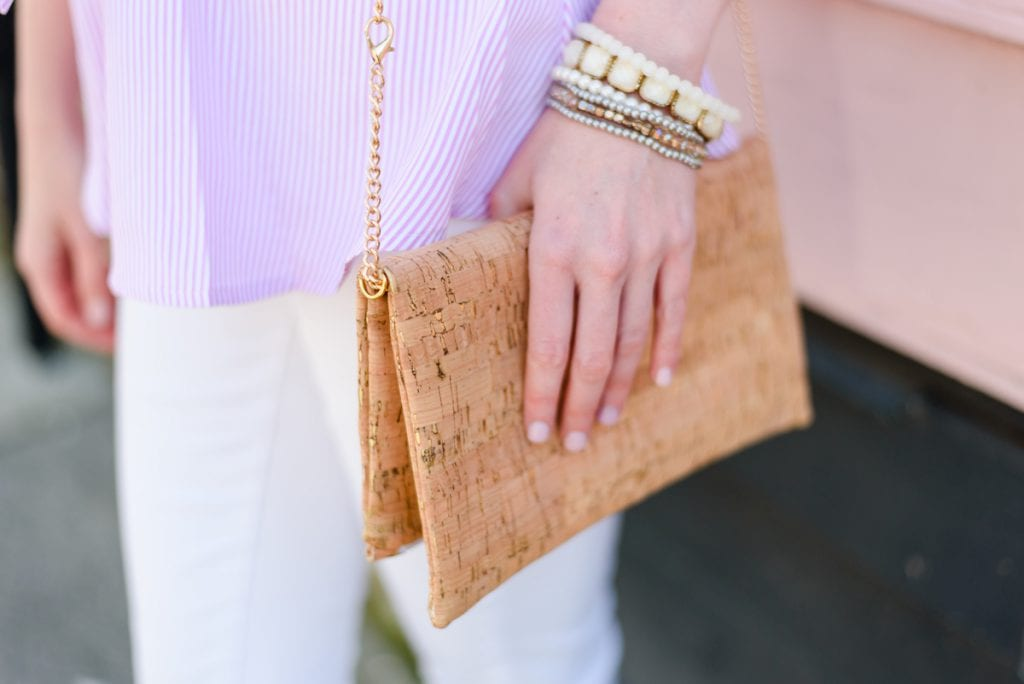 Life With Ashley T wearing cork clutch with stacked bracelets