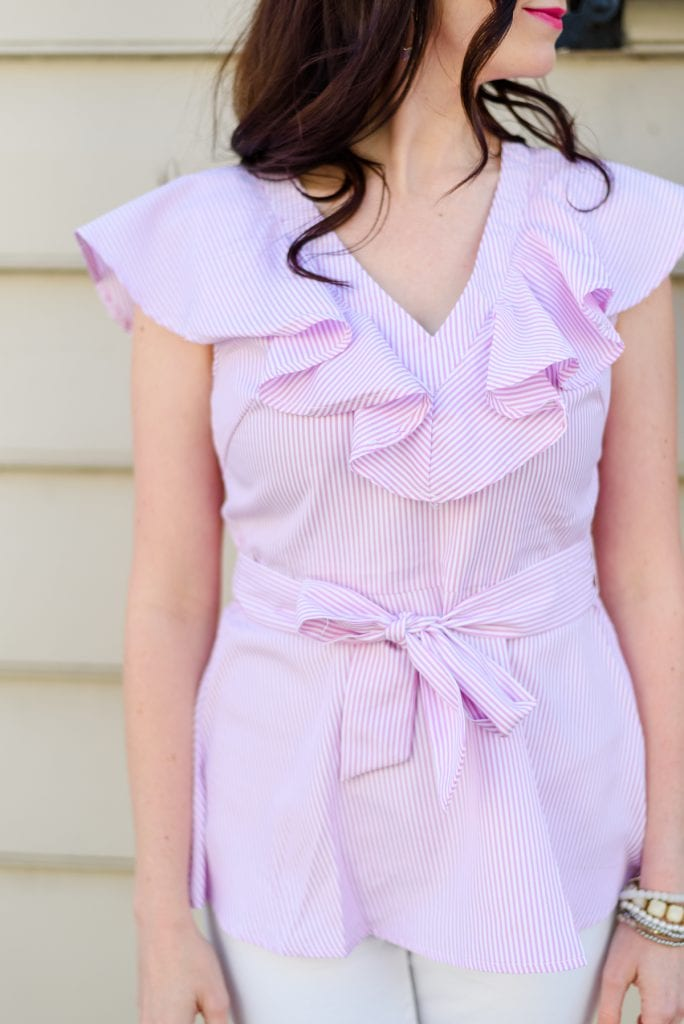 Life With Ashley T wearing a pink ruffle top, perfect for Spring