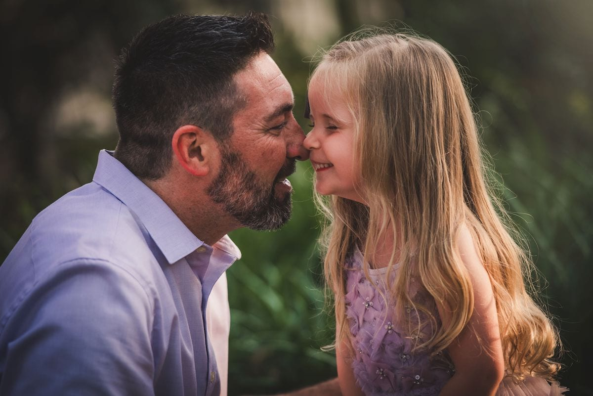 Dad and daughter rubbing noses