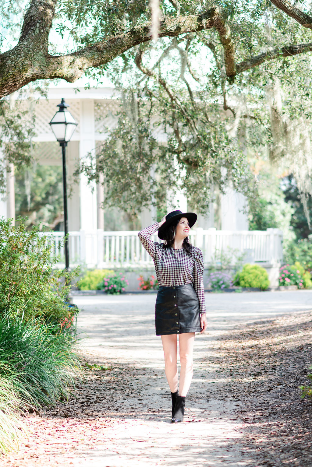 black-jacquard-leather-skirt-booties-suede-tory-burch-hat