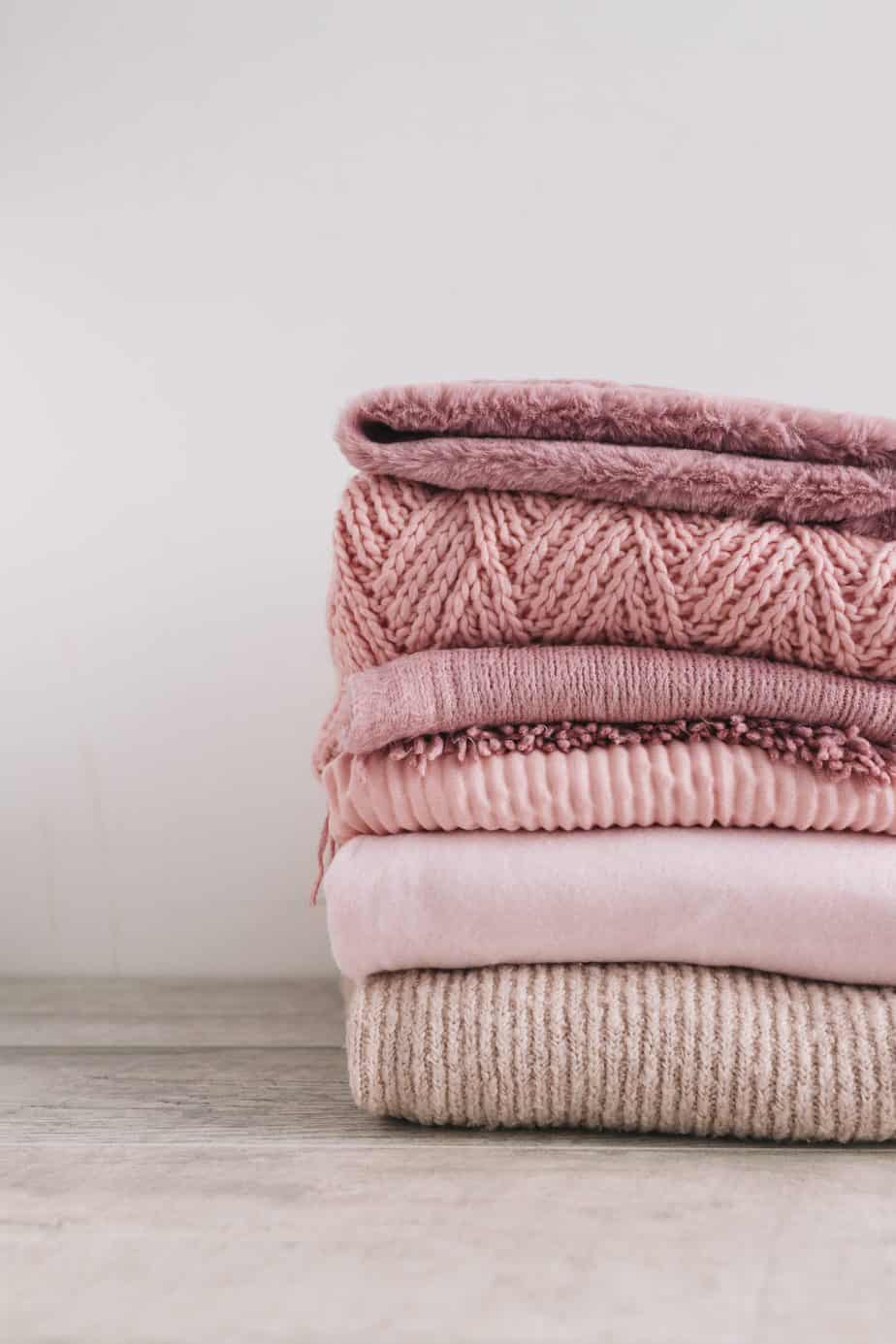 stack-knitted-sweaters-floor-winter-styles